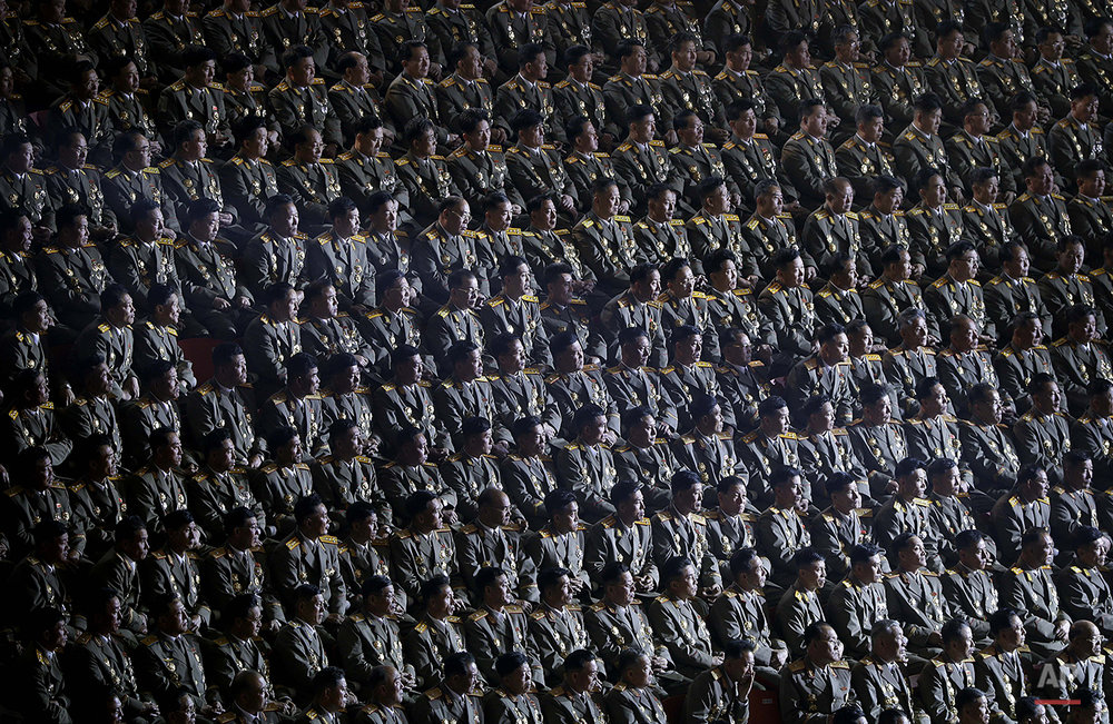 Military soldiers watch a joint concert between the Moranbong band and the State Merited Chorus in Pyongyang, North Korea, Sunday, Oct. 11, 2015. The performance was part of the 70th anniversary celebrations of the founding of the ruling Workers' Party. (AP Photo/Wong Maye-E)