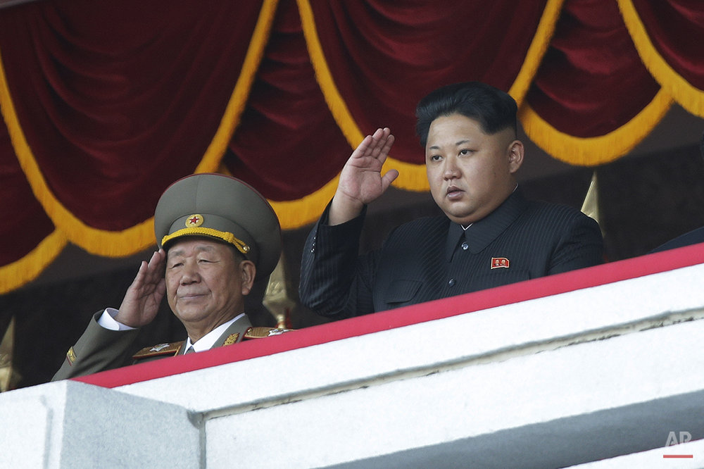 North Korean leader Kim Jong Un, right, salutes at a parade in Pyongyang, North Korea, Saturday, Oct. 10, 2015. North Korean leader Kim Jong Un declared Saturday that his country was ready to stand up to any threat posed by the United States as he spoke at a lavish military parade to mark the 70th anniversary of the North's ruling party and trumpet his third-generation leadership. (AP Photo/Wong Maye-E)