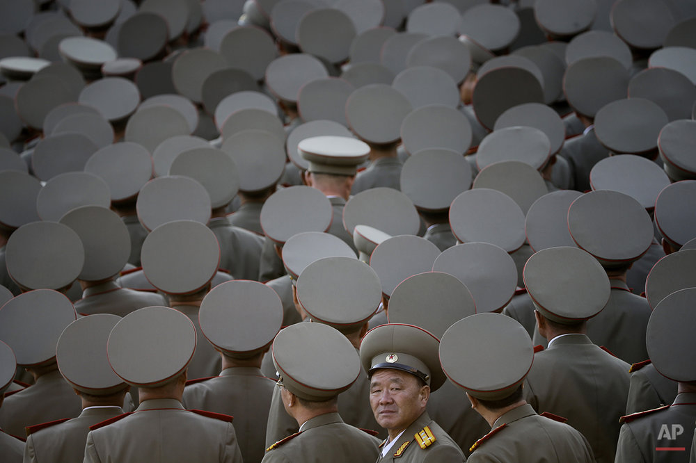 In this Oct. 10, 2015 photo, North Korean veterans gather before the start of a parade in Pyongyang, North Korea. North Korean leader Kim Jong Un declared Saturday that his country was ready to stand up to any threat posed by the United States as he spoke at a lavish military parade to mark the 70th anniversary of the North's ruling party and trumpet his third-generation leadership. (AP Photo/Maye-E Wong, File)