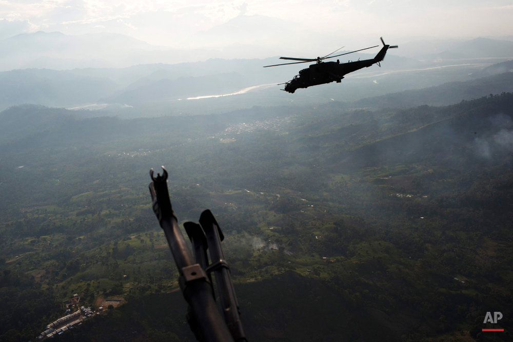 In this Sept. 19, 2014, file photo, a military attack helicopter flies over Pichari, Peru in the Apurimac, Ene and Mantaro river valley, or VRAEM. It is the world's No. 1 coca-growing region. Roughly half of Peruís cocaine exports have been ferried eastward, police say, since the rugged Andean nation became the worldís leading producer of the drug in 2012. (AP Photo/Rodrigo Abd, File)