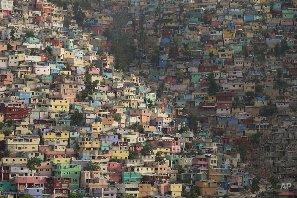 In this June 29, 2015 photo, houses pack a hillside in the Jalousie district of Port-au-Prince, Haiti. Haiti suffered from a severe housing shortage even before the 2010 earthquake. According to a January 2015 report by Amnesty International, the earthquake further increased the deficit. Meanwhile reconstruction efforts focused on building temporary shelters over permanent housing. (AP Photo/Rebecca Blackwell)