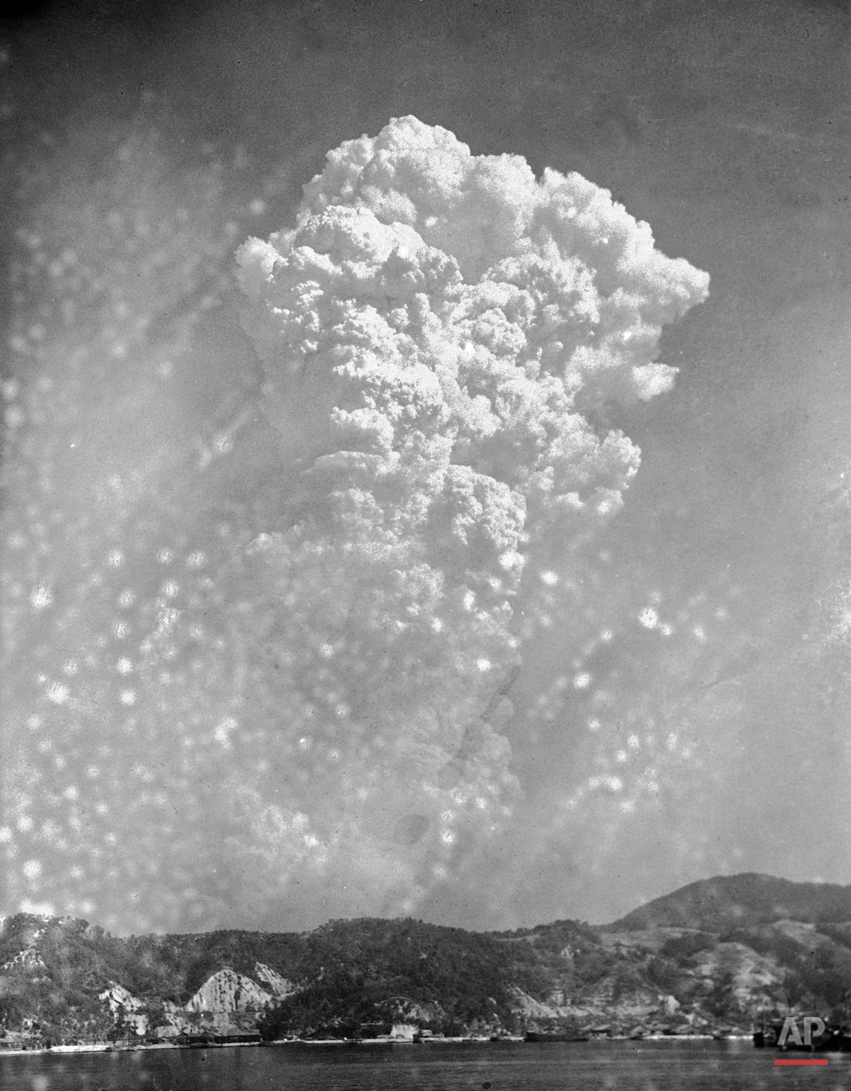 In this Aug. 6, 1945, photo, smoke rises around 20,000 feet above Hiroshima, Japan, after the first atomic bomb was dropped. On two days in August 1945, U.S. planes dropped two atomic bombs, one on Hiroshima, one on Nagasaki, the first and only time nuclear weapons have been used. Their destructive power was unprecedented, incinerating buildings and people, and leaving lifelong scars on survivors, not just physical but also psychological, and on the cities themselves. Days later, World War II was over. (AP Photo)