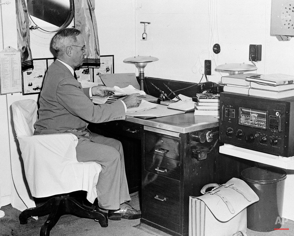 In this Aug. 6, 1945, photo, aboard the cruiser Augusta, President Harry S. Truman, with a radio at hand, reads reports of the first atomic bomb raid on Japan, while en route home from the Potsdam conference. On two days in August 1945, U.S. planes dropped two atomic bombs, one on Hiroshima, one on Nagasaki, the first and only time nuclear weapons have been used. Their destructive power was unprecedented, incinerating buildings and people, and leaving lifelong scars on survivors, not just physical but also psychological, and on the cities themselves. Days later, World War II was over. (AP Photo)
