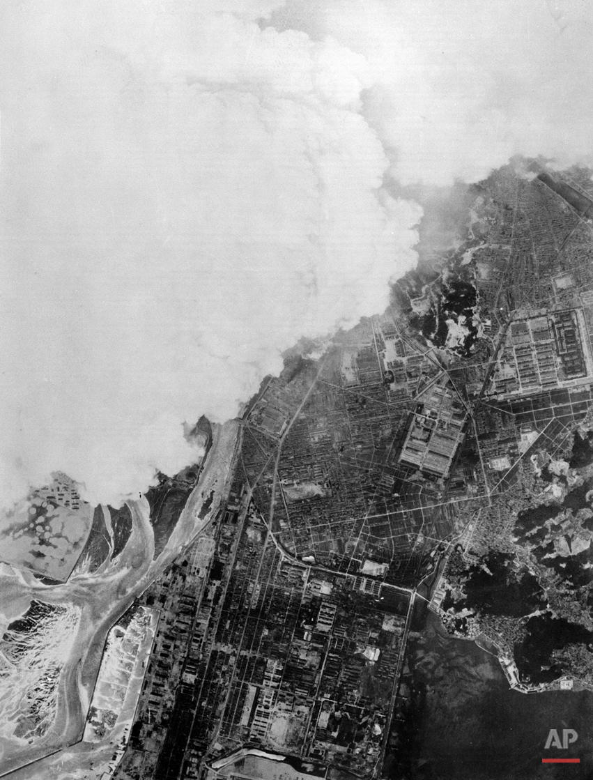 White smoke rises from detonation of the atom bomb over Hiroshima, Aug. 6, 1945.  Photo was made from 25,000 feet after the bomb hit its target. (AP Photo/U.S. Air Force)