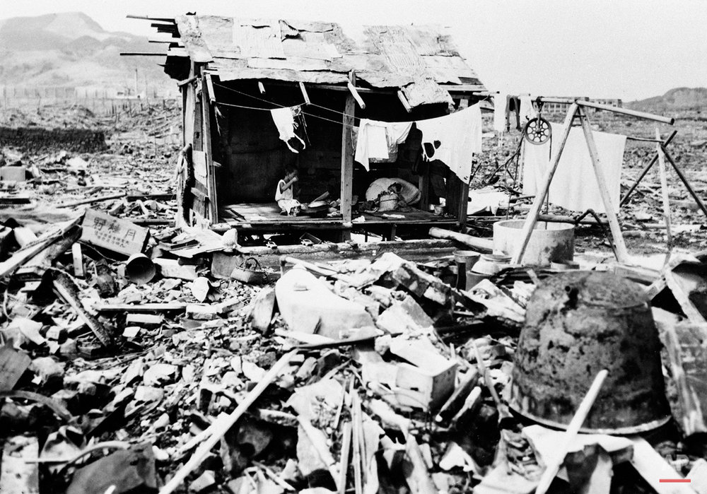A Japanese family eats rice in the crude shack they built from the wreckage left on the spot where their home once stood in Nagasaki, Sept. 14, 1945.  (AP Photo)