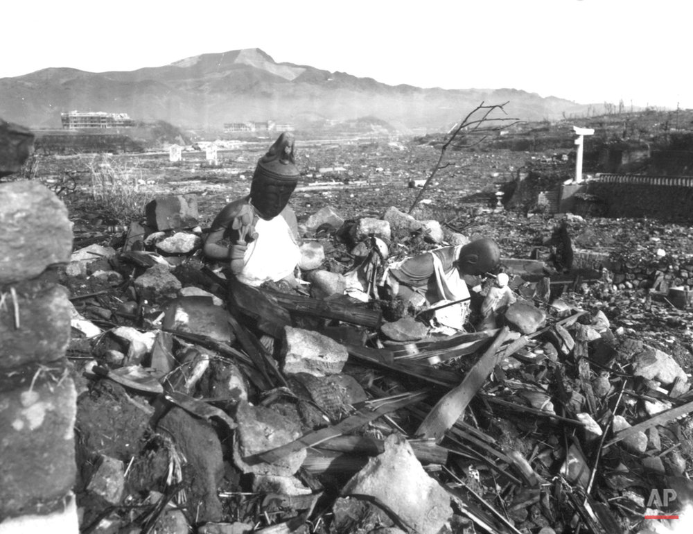 A battered religious figure stands witness on a hill above a burn-razed valley at Nagasaki, on September 24, 1945, after the second atomic bomb ever used in warfare was dropped by the U.S. over the Japanese industrial center. The bombing killed more than 70,000 people instantly, with ten thousands dying later from effects of the radioactive fallout. (AP Photo)