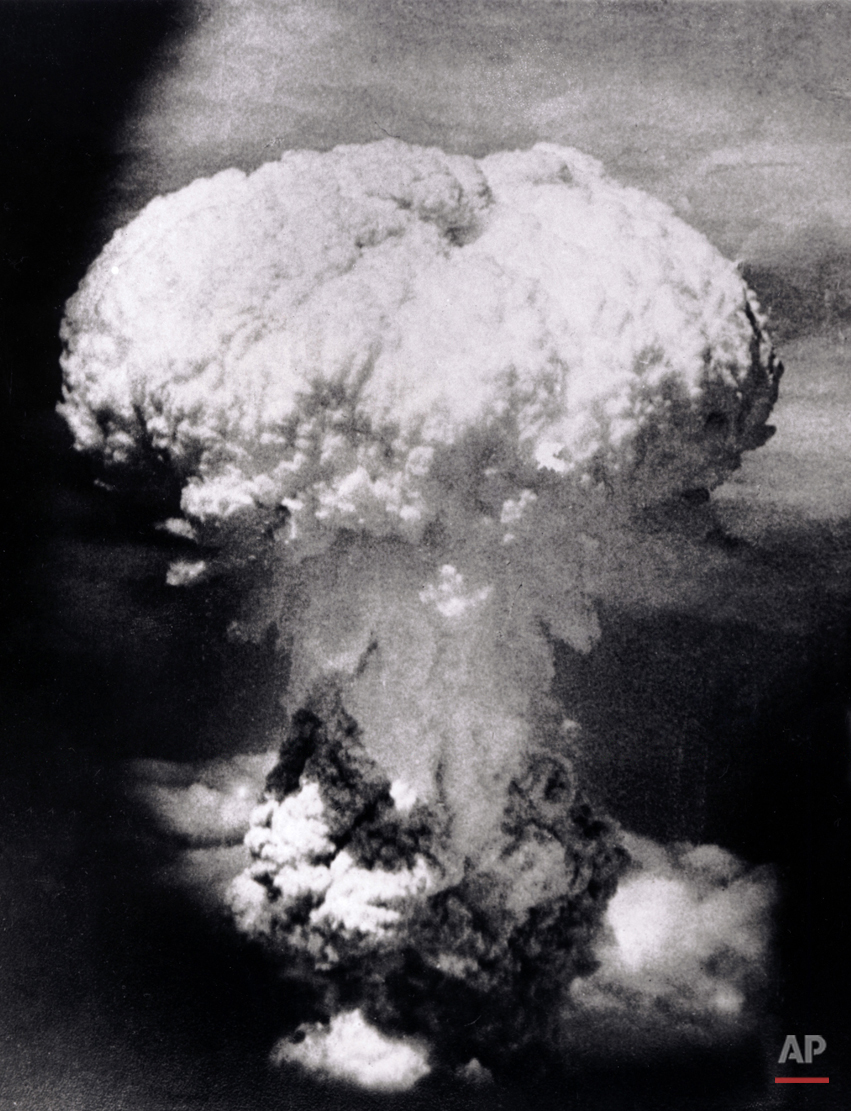 In this photo provided by the U.S. Signal Corps, a massive column of billowing smoke, thousands of feet high, mushrooms over the city of Nagasaki, Japan, after an atomic bomb was dropped by the United States on Aug. 9, 1945. A B-29 plane delivered the blast killing approximately 70,000 people, with thousands dying later of radiation effects. The attack came three days after the U.S. dropped the world's first atomic bomb on the Japanese city of Hiroshima. The attacks brought about Japan's unconditional surrender, and the war ended when the papers ofsurrender were accepted aboard the U.S. battleship Missouri on Sept. 2, 1945. (AP Photo/U.S. Signal Corps)