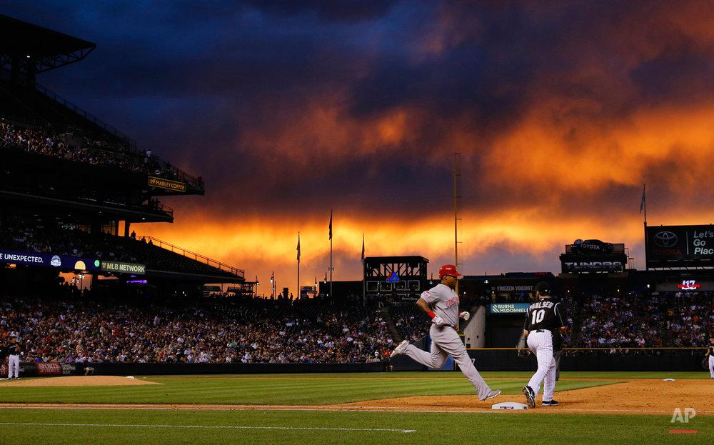 APTOPIX Reds Rockies Baseball