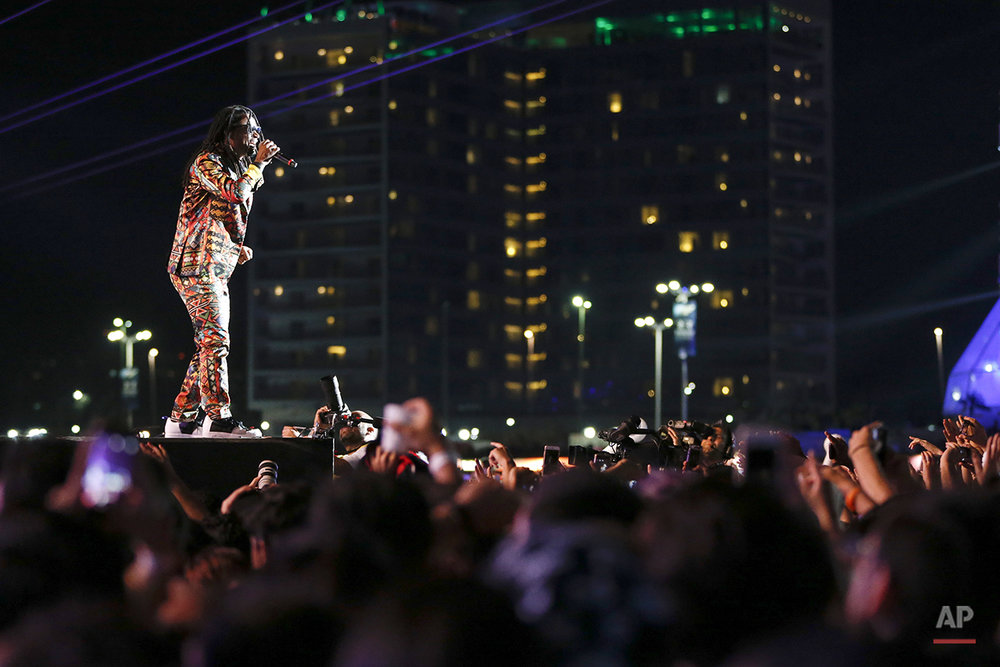Toni Garrido of the Brazilian band Cidade Negra performs at the Rock in Rio music festival in Rio de Janeiro, Brazil, Sunday, Sept. 27, 2015. (AP Photo/Felipe Dana)