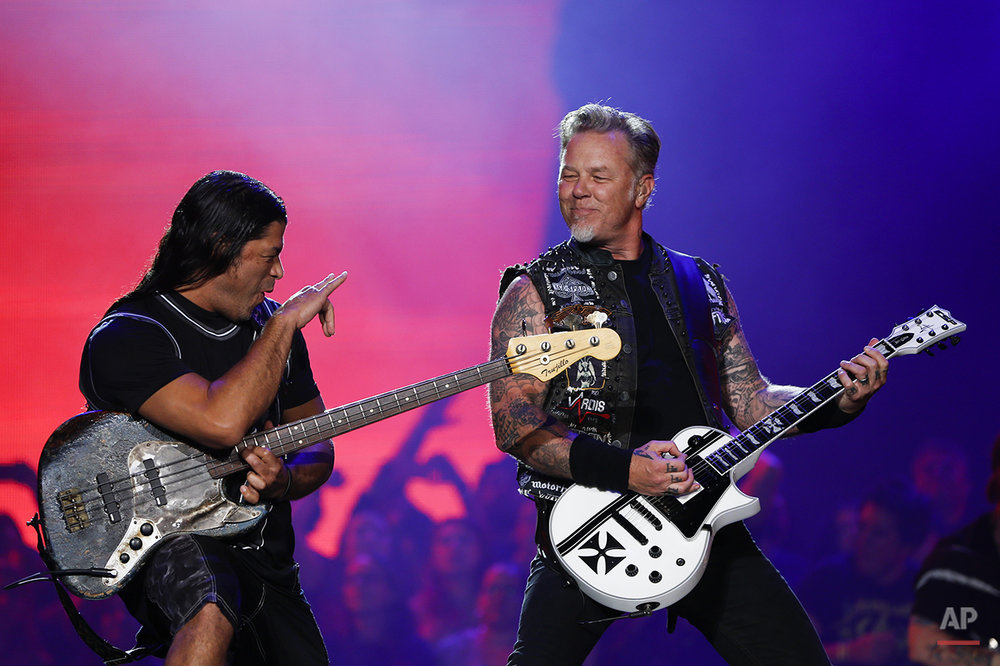 James Hetfield, right, and Robert Trujillo of Metallica perform at the Rock in Rio music festival in Rio de Janeiro, Brazil, early Sunday, Sept. 20, 2015. (AP Photo/Felipe Dana)