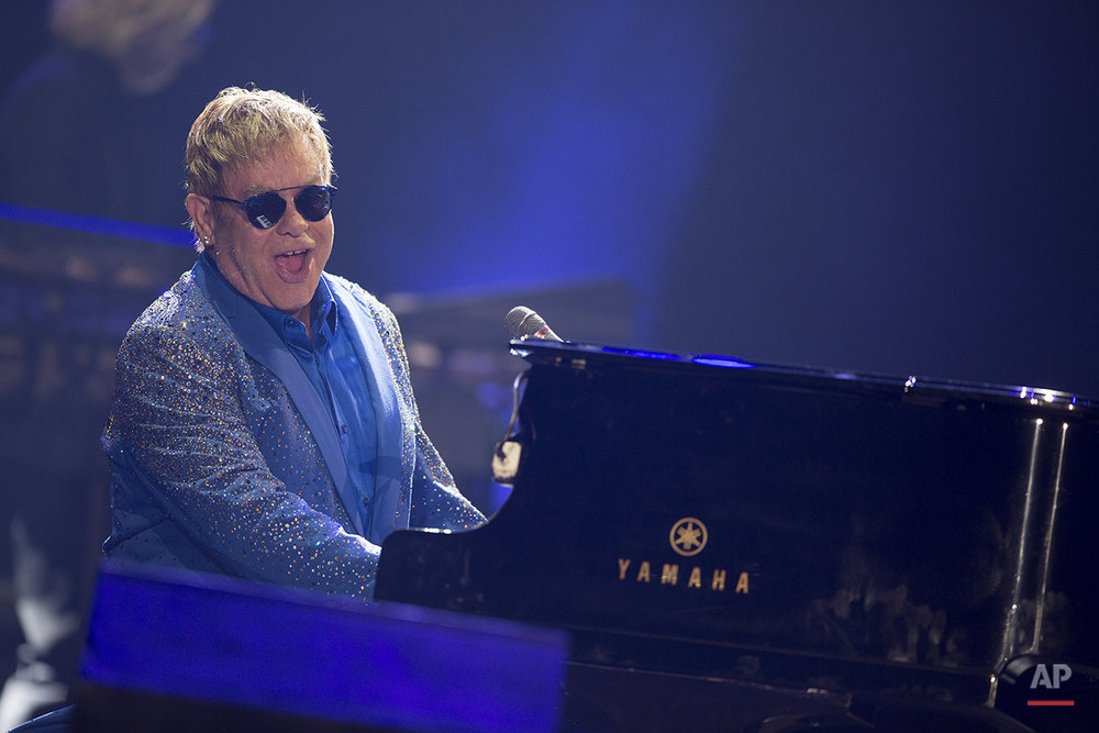The British singer Sir Elton John performs at the Rock in Rio music festival in Rio de Janeiro, Brazil, Sunday, Sept. 20, 2015. (AP Photo/Leo Correa)
