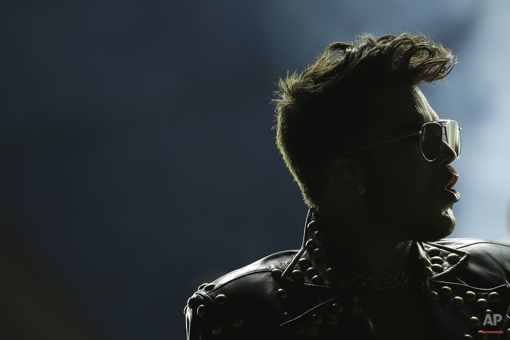 Adam Lambert of the Queen + Adam Lambert performs at the Rock in Rio music festival in Rio de Janeiro, Brazil, early Saturday, Sept. 19, 2015. (AP Photo/Felipe Dana)