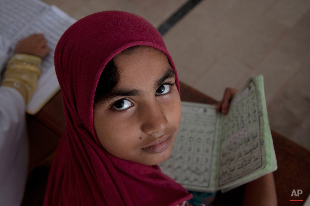Pakistani girls attend madrassa or a religious school to learn Quran, in Karachi, Pakistan, Monday, Aug 31, 2015. (AP Photo/Shakil Adil)