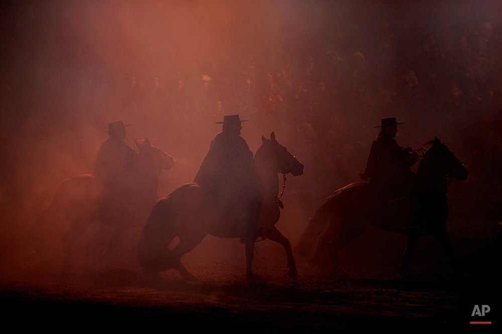 Horse riders perform at the inauguration of the Rural Society's annual exposition in Buenos Aires, Argentina, Saturday July 31, 2010.  (AP Photo/Natacha Pisarenko)