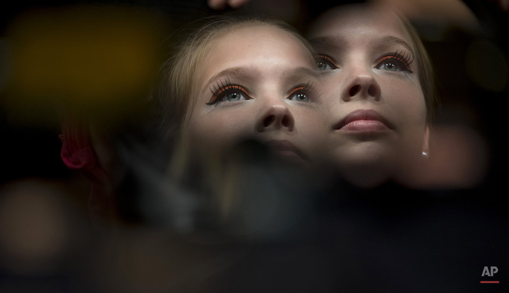A model is seen reflected on a mirror backstage during the 2013 Buenos Aires Fashion Week in Buenos Aires Argentina, Tuesday, Feb. 26, 2013. (AP Photo/Natacha Pisarenko)