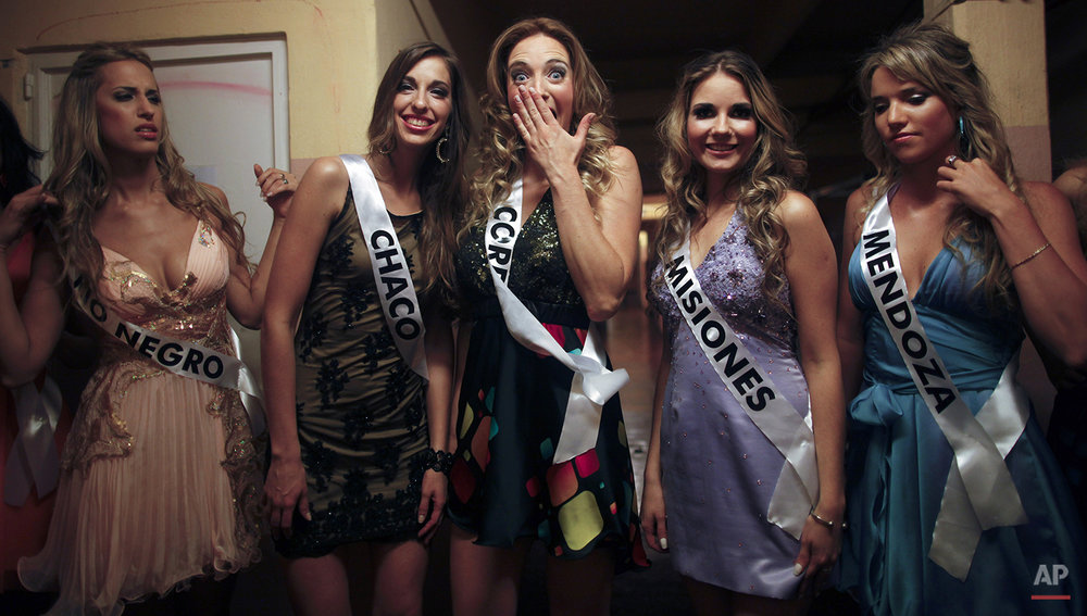 Contestants wait to go on stage during the Miss Argentina contest in Buenos Aires, Argentina, Wednesday, Nov. 7, 2012.  Camila Solorzano, from the Tucuman province, won the competition for a place in 2012 Miss Universe contest on December 19th in Las Vegas.(AP Photo/Natacha Pisarenko)