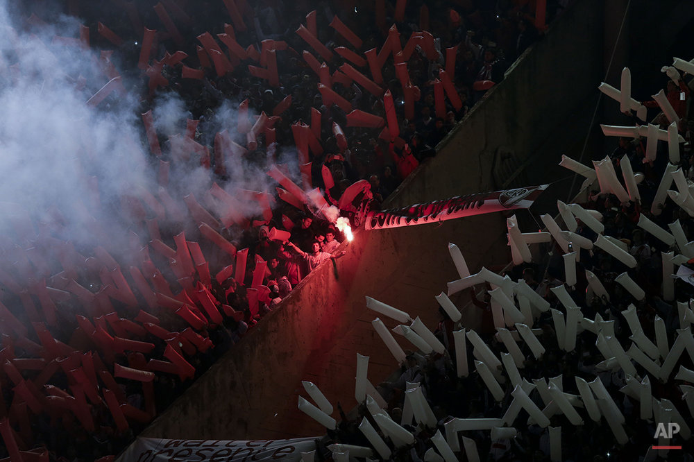 River Plate fans cheer for their team before a Copa Libertadores soccer match against Boca Juniors in Buenos Aires, Argentina, Thursday, May 7, 2015.(AP Photo/Natacha Pisarenko)