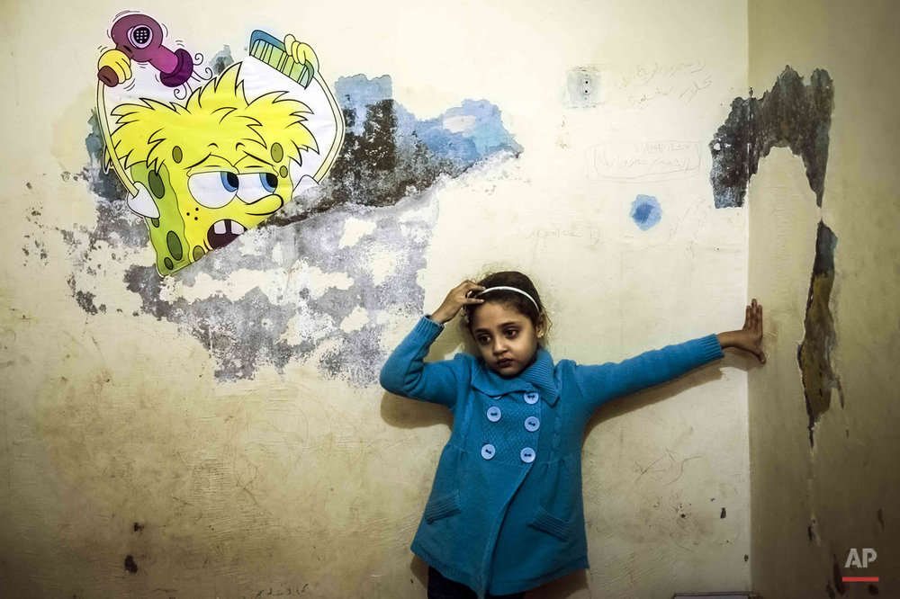 "In this picture taken on Feb. 7, 2015, Jana Amr Elbana, a 5-year-old girl whose father supported the Muslim Brotherhood and was shot to death protesting in 2014, stands in her bedroom at her home in Badrashin, south Giza, Egypt. ìKids have different understandings for what they experience, and they are psychologically affected by different things than adults,"" says psychiatrist Eman Gaber, who leads a rehabilitation program for traumatized children. ìThe pain doesnít come to the person who is dead, but to the ones that are still alive.î (AP Photo/Hamada Elrasam)"
