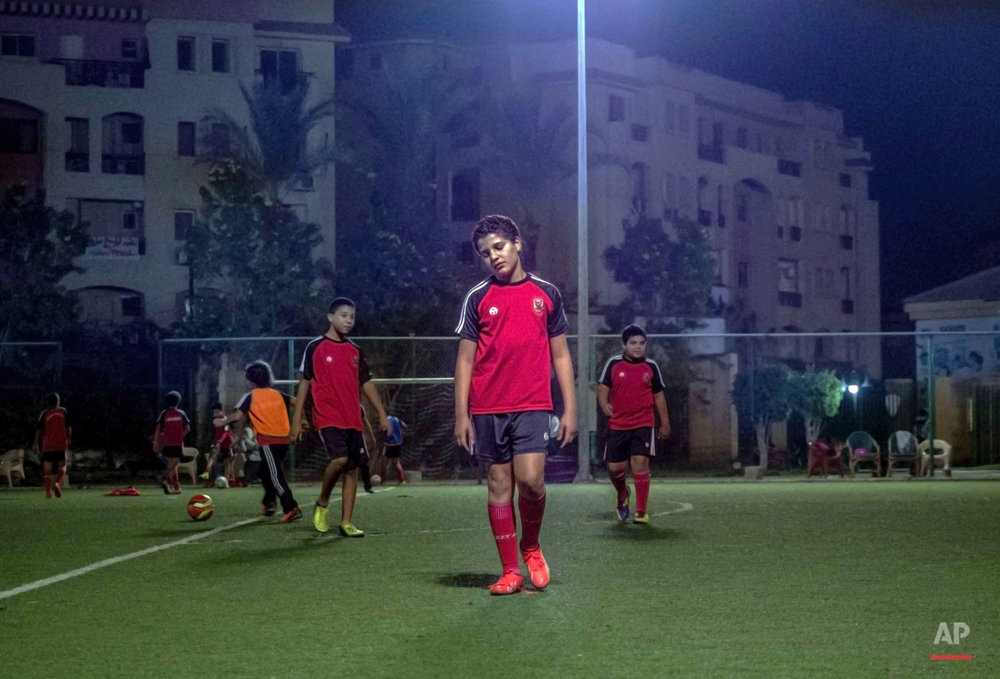 In this picture taken on Nov. 6, 2014, 13-year-old Adham Ehab Anwar, whose policeman father was shot to death in an attack on his station after the bloody security force breakup of Islamist sit-ins in Cairo in 2013, is tired after football training at the Al-Ashgar club in 6 October city, a suburb southwest of Cairo, in Giza, Egypt. Hidden scars remain for children who grew up during the chaos following years of turmoil after the 2011 uprising. The grief touches children of all kinds in Egypt, cutting across Christian and Muslim families, the sons of the outlawed Muslim Brotherhood group to the daughters of police officers and soldiers. And how they process the sorrow varies widely. (AP Photo/Hamada Elrasam)