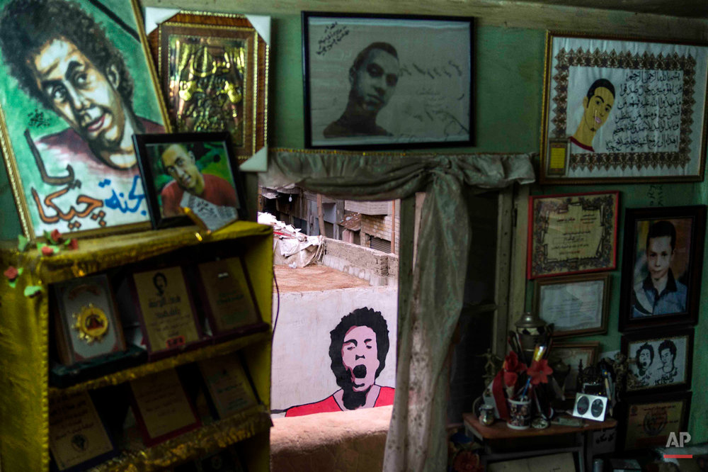 This picture taken Dec. 17, 2014 shows the bedroom of the late Gaber Salah, a teenage activist who was known by the nickname 'Gika', in Abdeen, downtown Cairo Egypt. Salah was shot dead by security forces in November 2012 on the first anniversary of the Mohammed Mahmoud street clashes. Thousands of people marched across Cairo for his funeral and his face became widely known and reproduced as graffiti on walls and many wore t-shirts representing him. (AP Photo/Hamada Elrasam)