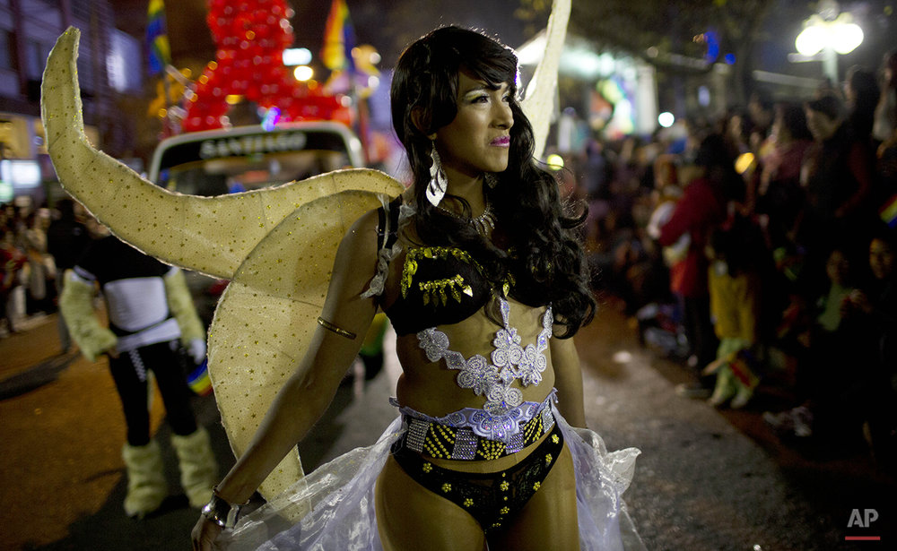 A reveler dressed as an angel participates in the annual gay pride parade in La Paz, Bolivia, Saturday, June 27, 2015. (AP Photo/Juan Karita)
