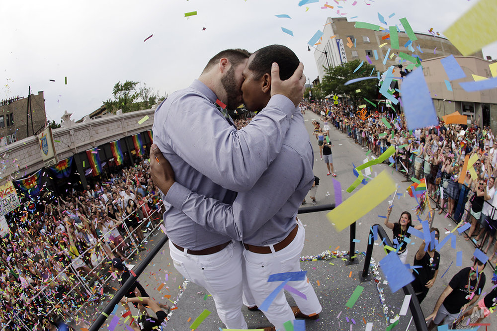 Scotty Brown, 32, left, of Chicago, kisses Roger Knight, 31, of Chicago, as they get married during the Chicago Pride Parade on Broadway Street on Sunday, June 28, 2015, in Chicago. (AP Photo/Nam Y. Huh)