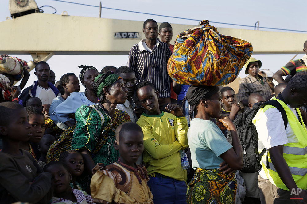 In this image taken Saturday May 23, 2015, refugees who fled Burundi's violence and political tension arrive in Kigoma, Tanzania, rafter making the journey on Lake Tanganyika. More than 90,000 have fled Burundi because they are afraid of getting caught in the violence which many have witnessed before.(AP Photo/Jerome Delay)