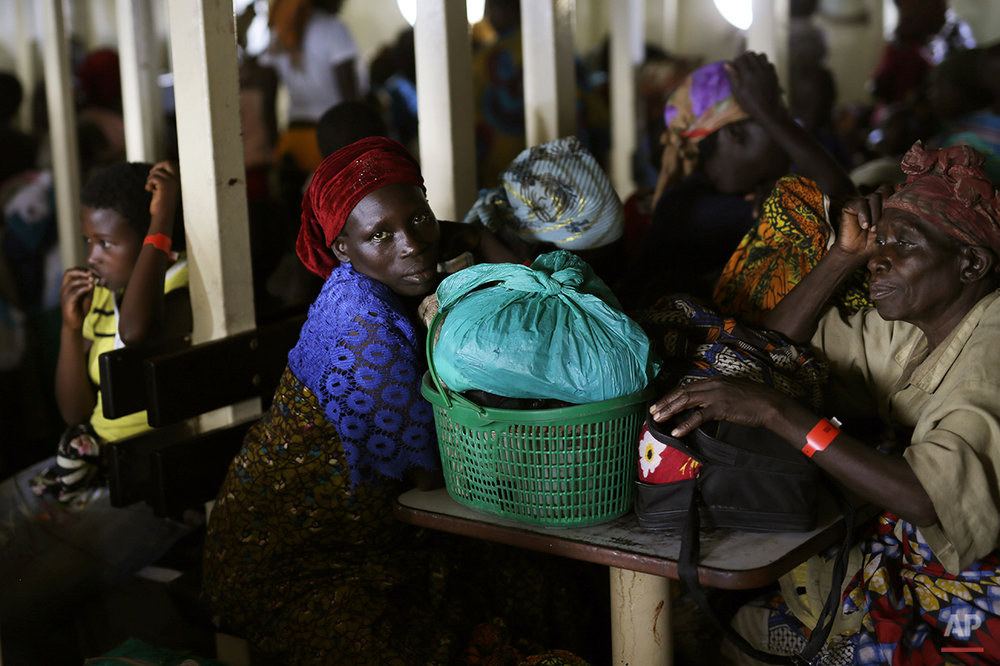 Refugees who fled Burundi's violence and political tension make the journey on Lake Tanganyika, Tanzania from Kagunga to the port city of Kigoma in a ship freighted by the UN, Saturday May 23, 2015. An outbreak of cholera has infected 3,000 people in a Tanzanian border region where refugees fleeing political unrest in Burundi have massed, the U.N. Refugee Agency said Friday, May 22, 2015. Some 300 to 400 new cases of cholera are being reported daily. At least 31 people — 29 refugees and two Tanzanians — already have died of the disease, according to UNHCR. More than 64,000 Burundians have fled to Tanzania in recent weeks, UNHCR said, escaping the unrest sparked by their president's bid for a third term that many say is unconstitutional. (AP Photo/Jerome Delay)