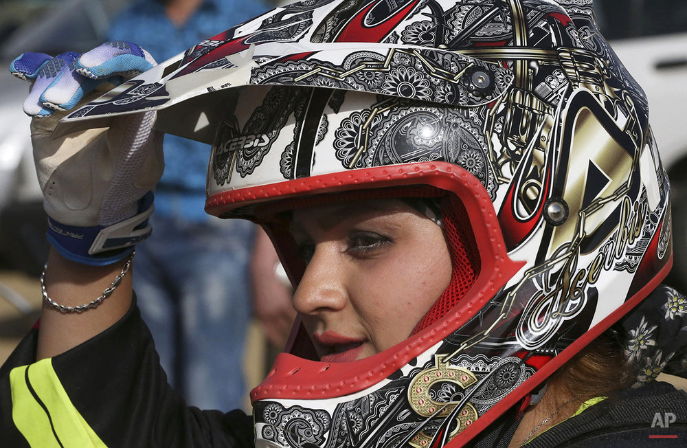 Mideast Iran Woman Motorcyclist Photo Gallery
