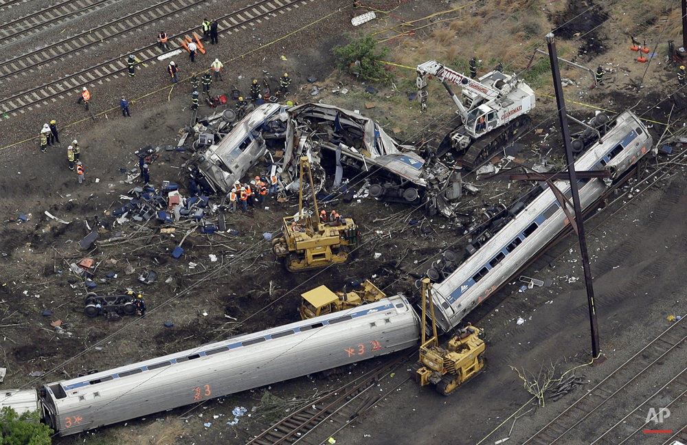 Emergency personnel work at the scene of a deadly Amtrak train derailment, Wednesday, May 13, 2015, in Philadelphia.  (AP Photo/Patrick Semansky)