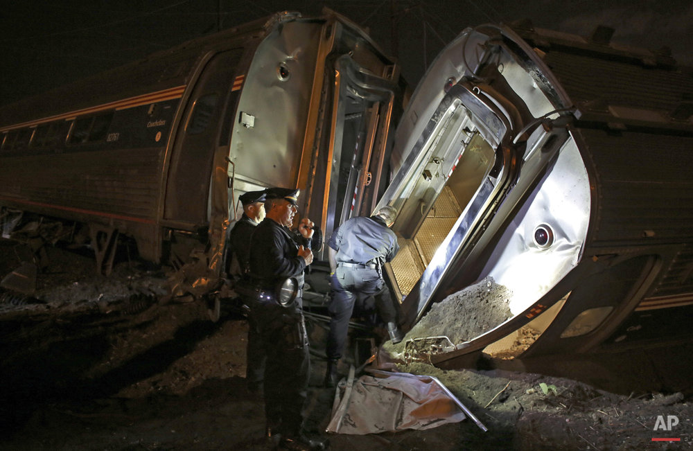 Emergency personnel work the scene of a Amtrak train wreck in Philadelphia, May 12, 2015.  (AP Photo/Joseph Kaczmarek)