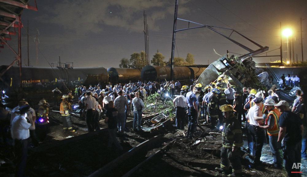 Emergency personnel work the scene of a Amtrak train wreck, Tuesday, May 12, 2015, in Philadelphia.  (AP Photo/ Joseph Kaczmarek)