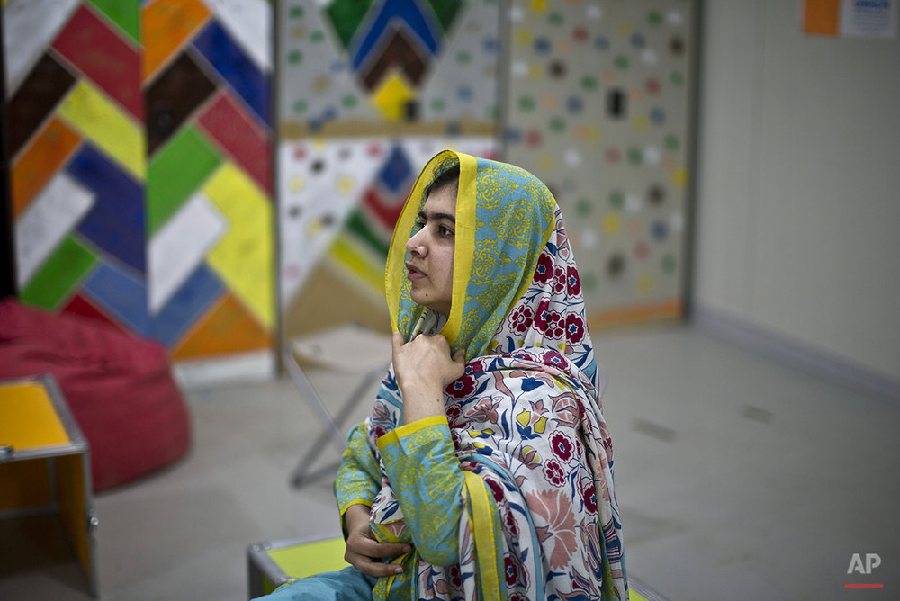 "Nobel Peace Prize laureate Malala Yousafzai, 18, adjusts her head scarf during her visit to Azraq refugee camp, Jordan, Monday, July 13, 2015. Rich countries should spend less on weapons in the Syria conflict and more on education, Nobel Peace Prize winner Malala Yousafzai said Monday, calling world leaders ""quite stingy"" as she visited the camp for Syrian war refugees. (AP Photo/Muhammed Muheisen)"