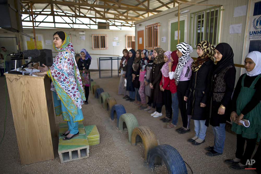 "Nobel Peace Prize laureate Malala Yousafzai, 18, left, answers a reporter's question during her visit to Azraq refugee camp, Jordan, Monday, July 13, 2015. Rich countries should spend less on weapons in the Syria conflict and more on education, Nobel Peace Prize winner Malala Yousafzai said Monday, calling world leaders ""quite stingy"" as she visited the camp for Syrian war refugees. (AP Photo/Muhammed Muheisen)"