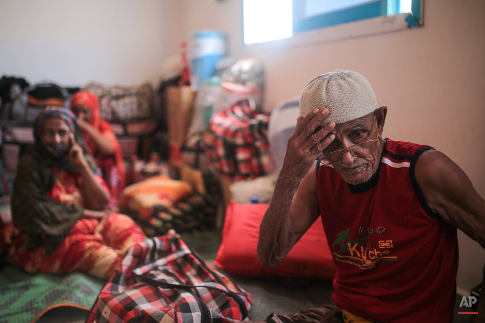 In this Tuesday, May 19, 2015 photo, Ibrahim Mohamed, 80, and the oldest refugee at the center, who is both blind and deaf, adjusts his hat, at an orphanage that has been turned into a center for Yemeni refugees, in Obock, northern Djibouti. Fleeing the war at home, thousands of Yemenis have made it across the Gulf of Aden to find refuge in Djibouti, a sleepy Horn of Africa nation where the United Nations has set up a staging hub for aid for the conflict-torn Arab country. (AP Photo/Mosa'ab Elshamy)