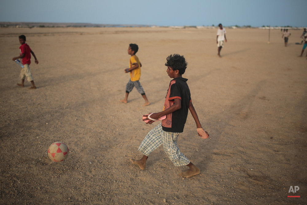 In this Wednesday, May 20, 2015 photo, Yemeni refugee boys play football outside their camp, in Obock, northern Djibouti. Many of the refugees are relieved to have escaped after two months of Saudi-led airstrikes targeting Yemenís Shiite rebels and fighting on the ground between rival factions that have pushed their country to the brink of collapse. (AP Photo/Mosa'ab Elshamy)