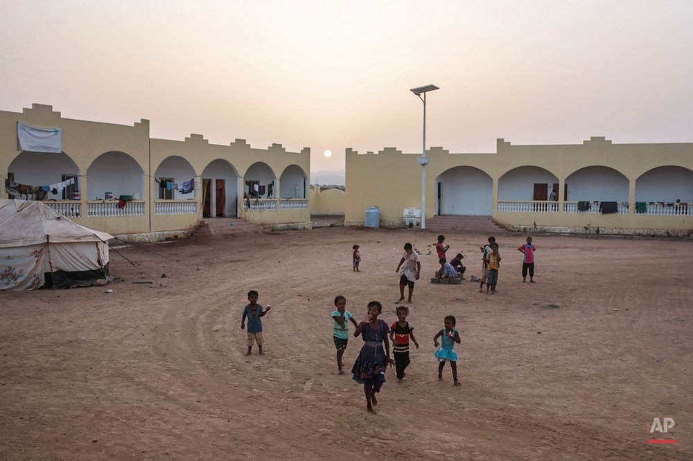 In this Wednesday, May 20, 2015 photo, Yemeni refugee children play outside their rooms at an orphanage that has been turned into a center for Yemeni refugees, in Obock, northern Djibouti. The UNHCR says a total of 5,000 Yemeni refugees have made it to Djibouti, including 3,000 in the capital, Djibouti city, and 1,000 in Obock, 300 kilometers (187 miles) to the north making it currently the biggest Yemeni refugee population. (AP Photo/Mosa'ab Elshamy)