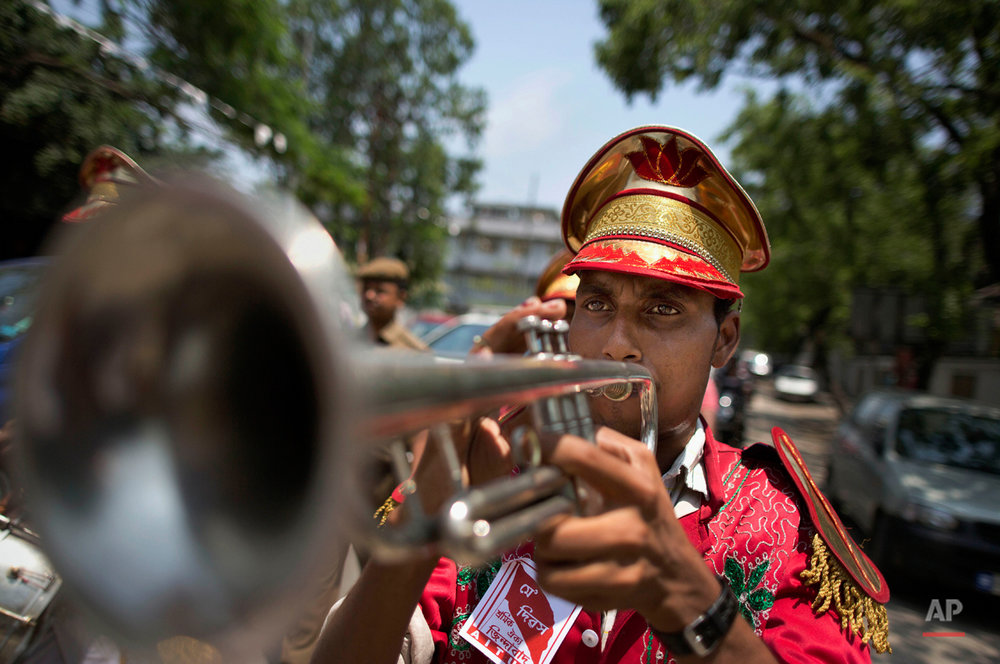 A member of a brass band plays an instrument during a rally to mark May Day in Gauhati, India, Friday, May 1, 2015. May 1 is celebrated as the International Labor Day or May Day across the world. (AP Photo/Anupam Nath)