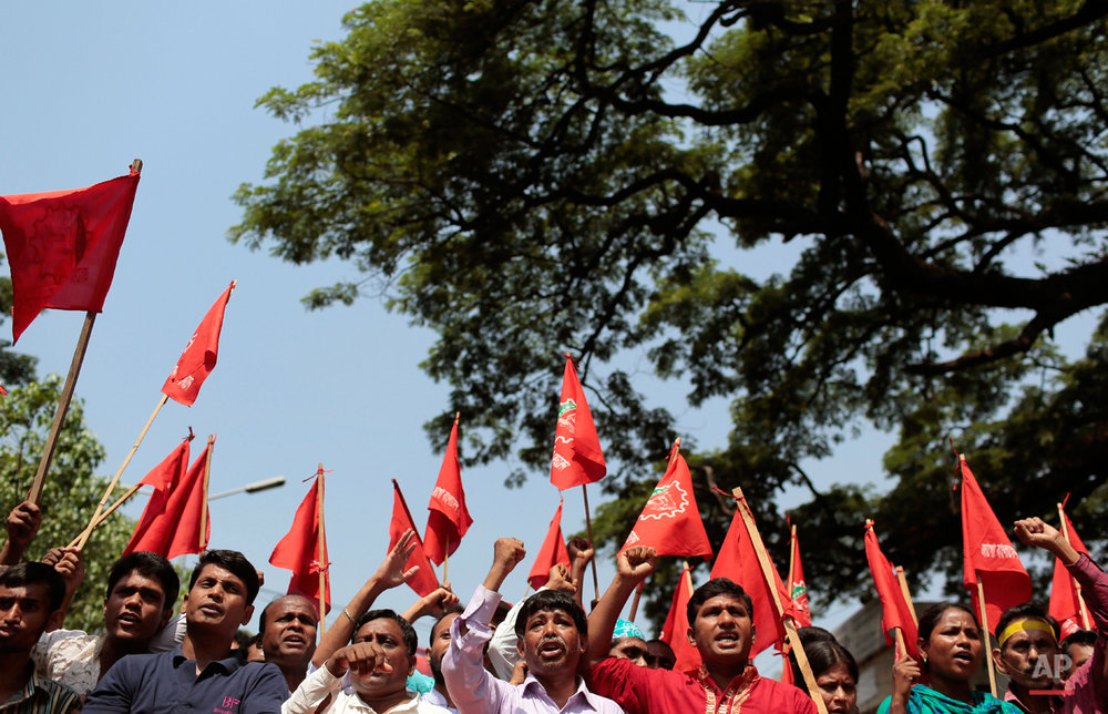 Bangladeshi garment workers and activists shout slogans during a May Day rally demanding better work environment, in Dhaka, Bangladesh, Friday, May 1, 2015. May 1 is celebrated as the International Labor Day or May Day across the world. (AP Photo/A.M. Ahad)