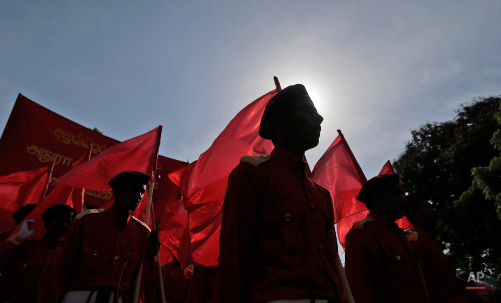 Activists of the Sri Lankan Marxist political party Peoples' Liberation Front march during a rally to mark International Labor Day in Colombo, Sri Lanka, Friday, May 1, 2015. (AP Photo/Eranga Jayawardena)