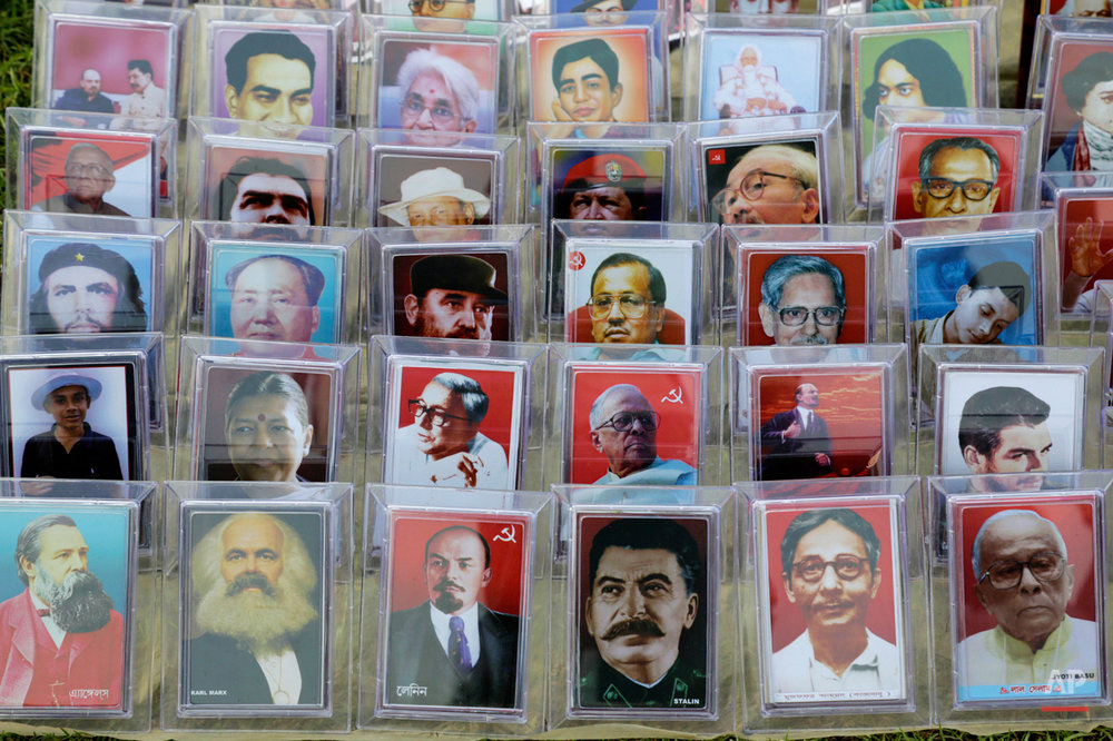 Portraits of Indian and world communist leaders is displayed for sale during a rally organized by left front trade unions celebrating International Labor Day, or May Day, in Kolkata, India , Friday, May 1, 2015. (AP Photo/Bikas Das)