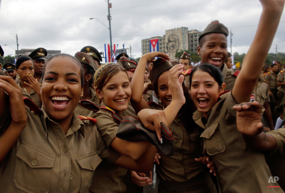 Cuban army cadets react to the photographer as they march in Revolution Square marking May Day, in Havana, Cuba, Friday, May 1, 2015. Thousands of people converged on the plaza for the traditional march, led this year by President Raul Castro and Venezuelan President Nicolas Maduro. (AP Photo/Ramon Espinosa)