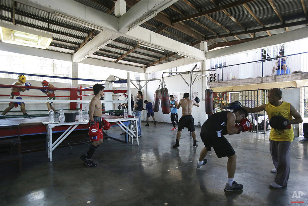 In this April 22, 2015, photo, Filipino boxers train at a boxing gym in suburban Paranaque, south of Manila, Philippines. The popularity of boxing in the Philippines has risen lately due, in part, to Filipino boxing icon Manny Pacquiao, who is set to face undefeated Floyd Mayweather Jr. on May 2 in Las Vegas. (AP Photo/Aaron Favila)