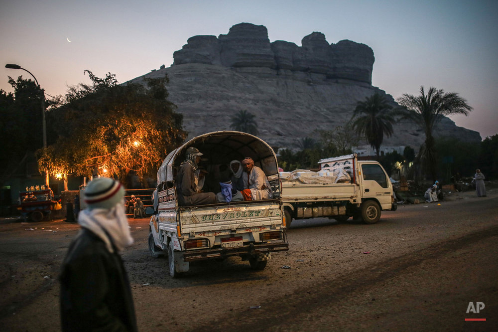 In this Wednesday, March 18, 2015 photo, quarry workers are transported in pickup trucks after dawn from Shurafa village, Minya, southern Egypt. Around 45,000 people, including children, work in an estimated 1,500 quarries, digging out stones that later will be used in construction or powdered to be used by pharmaceutical and ceramic companies.(AP Photo/Mosa'ab Elshamy)