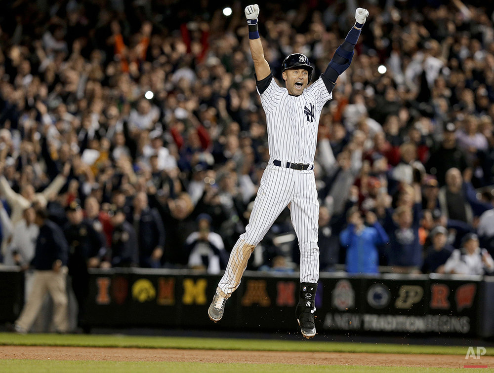 New York Yankees' Derek Jeter jumps after hitting the game-winning single against the Baltimore Orioles in the ninth inning of a baseball game, Thursday, Sept. 25, 2014, in New York. The Yankees won 6-5. (AP Photo/Julie Jacobson)