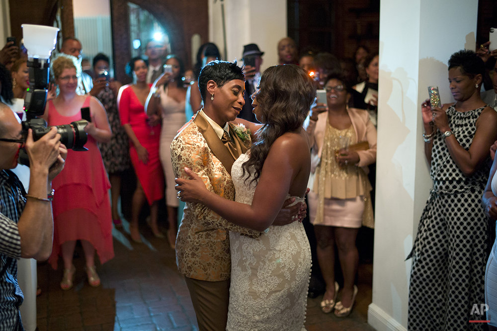 NBA referee Violet Palmer, center left, and her partner Tanya Stine dance during their wedding reception on Friday, Aug. 1, 2014, in Los Angeles. In an interview with The Associated Press, Palmer says she came out to her fellow NBA referees in 2007. (AP Photo/Jae C. Hong)