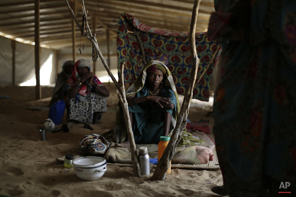 Nigerians who fled Boko Haram to Chad sit inside a tent at the Baga Solo refugee camp near the shore of Lake Chad, Wednesday March 4, 2015. The camp, jointly run by the Chadian government and UNHCR, opened mid-January 2015 and hosts over 6000 refugees. Officials say that several thousand had arrived in Chad by the end of 2014 as Boko Haram intensified its attacks in the area. (AP Photo/Jerome Delay)