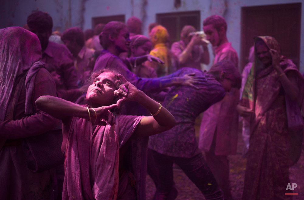 In this Tuesday, March 3, 2015 photo, Indian Hindu widows and others play with colored powder as part of Holi celebrations at the Meera Sahabhagini Widow Ashram in Vrindavan, India. The widows celebrated the Hindu festival of colors at the ashram. (AP Photo/Tsering Topgyal)