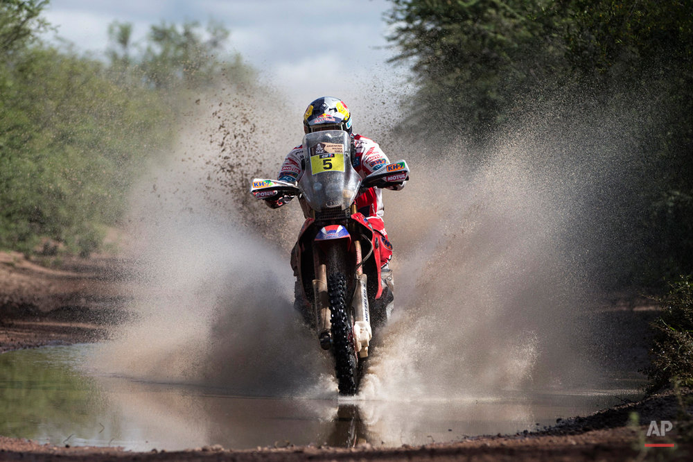 Honda rider Helder Rodrigues of Portugal races during the eleventh stage of the Dakar Rally 2015 between the cities of Termas de Rio Hondo and Rosario, Argentina, Friday, Jan. 16, 2015. The race returned to Argentina after passing through Bolivia and Chile and will finish on Jan. 17 in Buenos Aires. (AP Photo/Felipe Dana)
