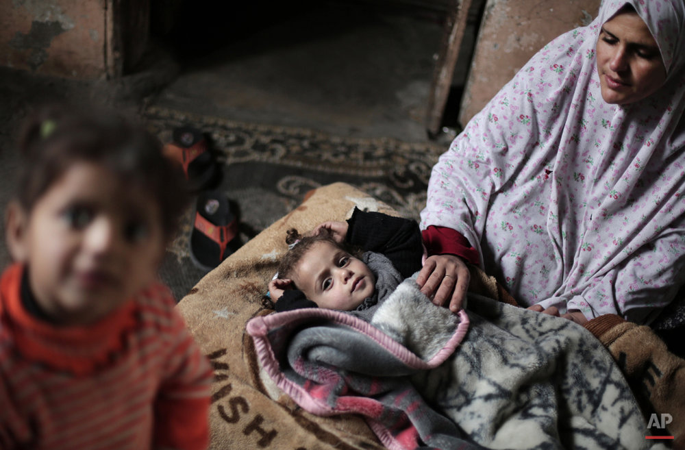 Mideast Gaza Wounded Girl Photo Essay